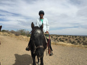 Me riding a black horse named Grant