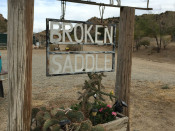 Broken Saddle Riding Tours sign