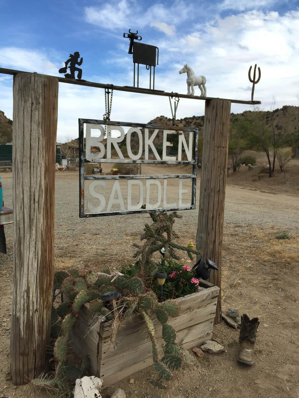 Broken Saddle Riding Tours sign