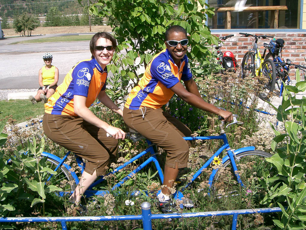 Jess and Kronda in matching jerseys on a tandem bike