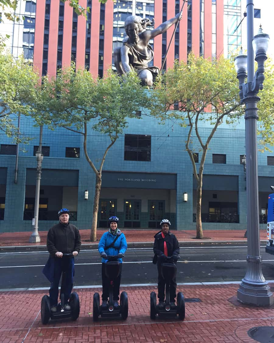 Chuck, Jess & Kronda on Segways in front of Portlandia Building