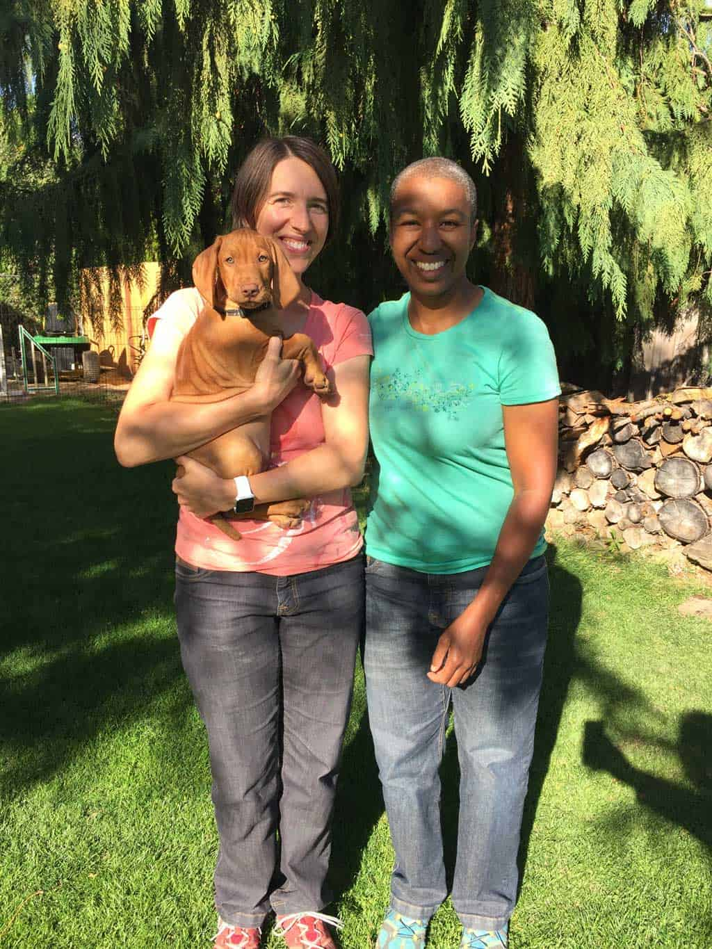 Jess and Kronda holding Obi on go home day.